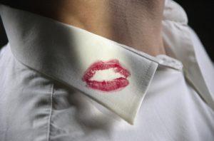 lipstick mark on white collared shirt